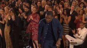 Chris Brown stays seated as others give Ocean a standing ovation